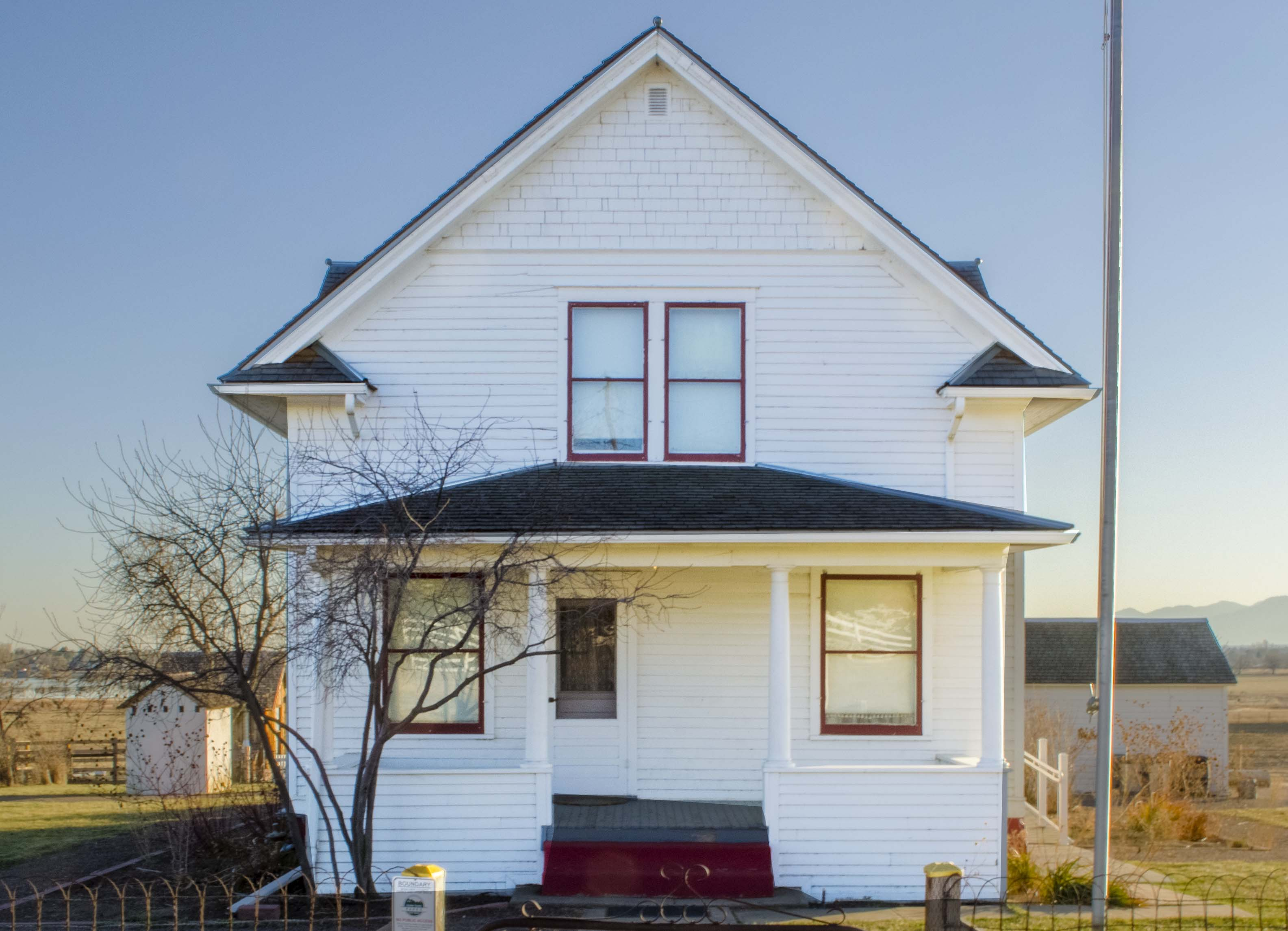 white classic colorado farmhouse west of longmont